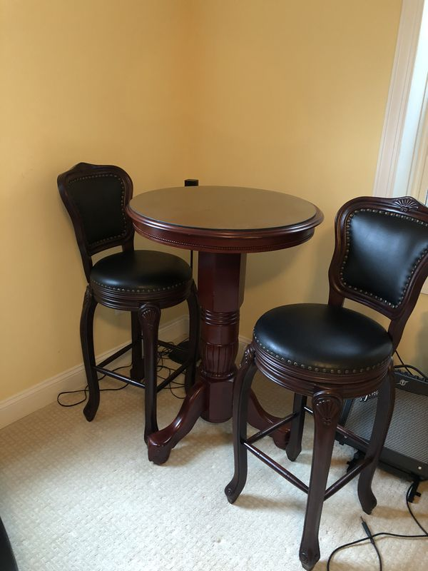 Cocktail table with two bar stools