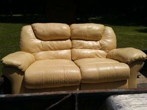 Leather love seat with recliners for Sale in Nashville, TN