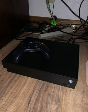 Xbox One X with Games/ Wireless Headphones for Sale in Marietta, GA