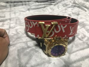 RED SUPREME LV GOLD BUCKLE BELT for Sale in Martinsburg, WV
