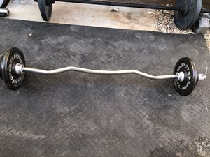 Standard curl bar with weight plates...$125 OBO for Sale in Glendale, AZ