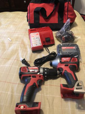 New Milwaukee 18 V drill set comes with two batteries one charger one impact gun and a drill this is not a hammer drill this is not a brushless set$1 for Sale in Lauderhill, FL
