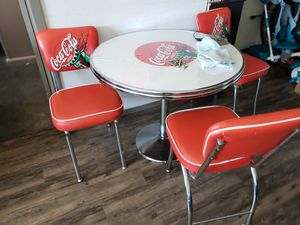 Coca Cola table w/ 3 CocaCola chairs great condition antique. for Sale in Los Angeles, CA