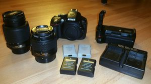Nikon D5300 camera with 2 lenses, 4 batteries, 1 charger, 1 battery grip, and 1 remote control!! for Sale in Orlando, FL