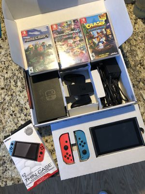 Nintendo switch with case, extra screen protector and three games. for Sale in Providence, RI