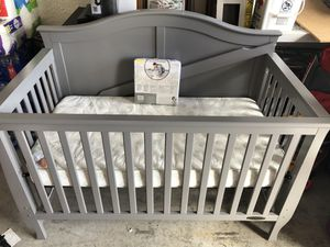 Gray baby crib with mattress for Sale in Cape Coral, FL