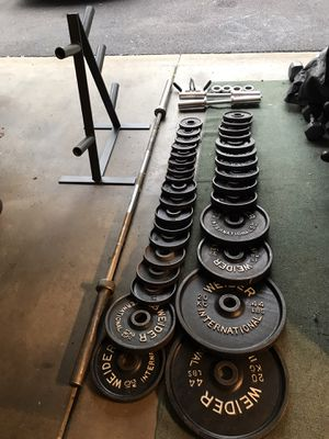 385lb Olympic weight set, 7ft 45lb Olympic bar, 2 Olympic dumbbells,& olympic plate tree $275 for Sale in Grayslake, IL