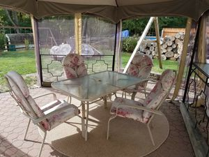 Patio glass table with 4 chairs & cushions, includes under table umbrella base folder ( umbrella not included) for Sale in Warrington, PA