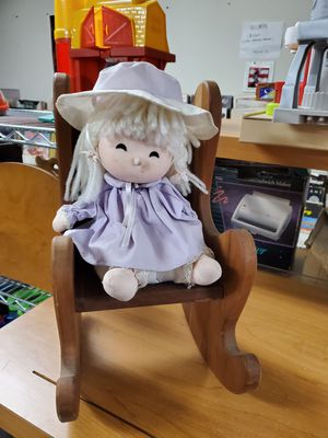 Wind up doll in a rocking chair for Sale in Erie, PA
