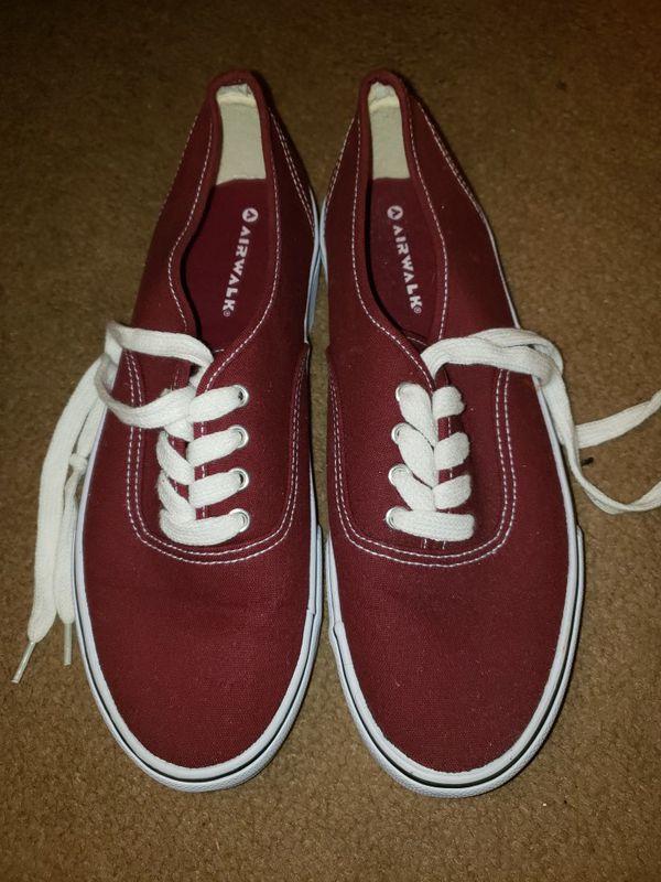 Maroon Airwalk shoes.