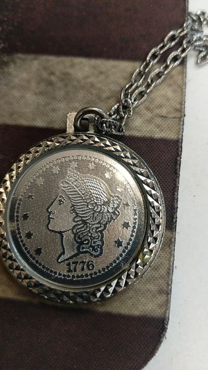 Silver covered coin with chain for Sale in Leesburg, VA