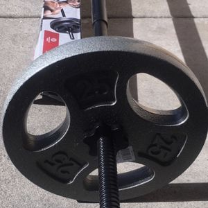 Weights 5ft straight bar with a set of 25lb plates (add more plates $2 a pound) for Sale in Covina, CA