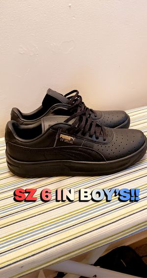 Black puma sneakers Size 6 Youth Kids for Sale in Buffalo, NY