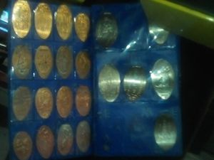 Disneyland pressed coin collection Alice in Wonderland Statue of Liberty the first one is State 1955 July 17td for Sale in Santa Ana, CA