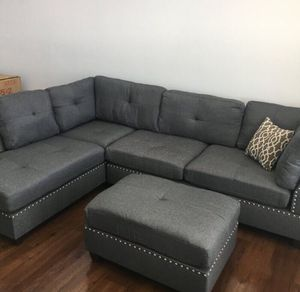 New in boxes grey sectional sofa ( ottoman included) reversible chaise for Sale in Long Beach, CA