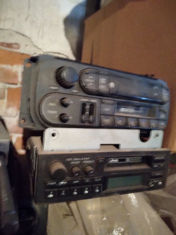 2 older car cassette radios.