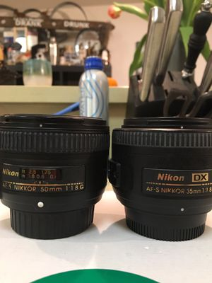 2 Nikon camera lenses one 50 mm and one 35 mm. Pictures show all writing and information on the camera lenses . Asking price for both $200.Or best o for Sale in Albany, CA