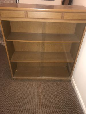 Wooden bookshelf with sliding glass doors. for Sale in Fort Washington, MD
