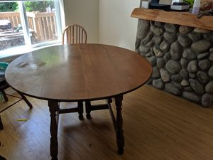 Dining room table and misc chairs for Sale in Sisters, OR