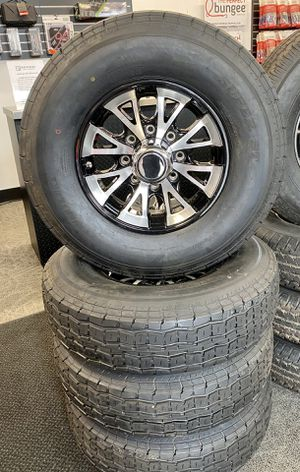 Set of (4) ST235/80R16 tires w/ 8 lug Aluminum wheels w/ center caps for Sale in Gresham, OR