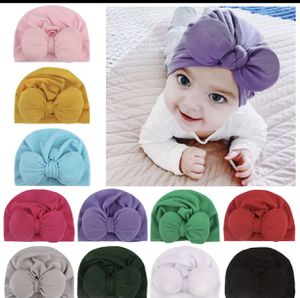 Color white beanie size newborn 0-3 for Sale in Austell, GA