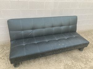 Black leather futon (little ripped at bottom as shown piece in picture) for Sale in Phoenix, AZ