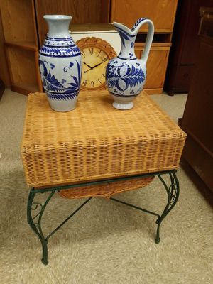 Spinning wicker top table w/ storage and green cast iron base for Sale in St. Louis, MO