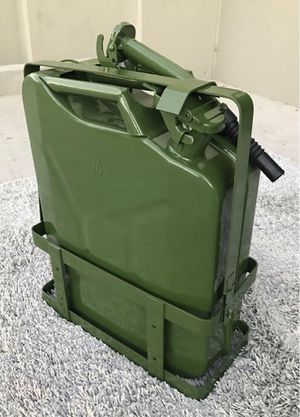 New in box 5 gallon 20 liter jerry can steel gas tank canister military green with holder included ? for Sale in Santa Fe Springs, CA