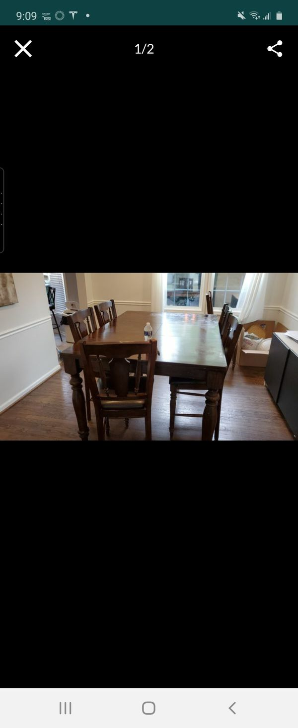 Dining table with chairs used .