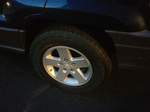 Jeep wheels 4 set good tires for Sale in Worcester, MA