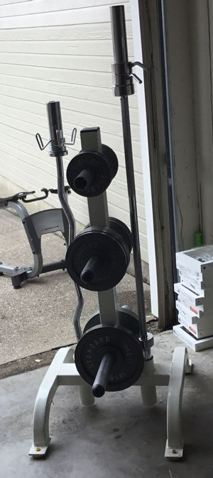 Cybex Plate Tree with Olympic Curl Bar, Shorty 5' Olympic Bar, and 140lbs of Weight Plates. I'm not selling the plates separately. for Sale in Dallas, TX