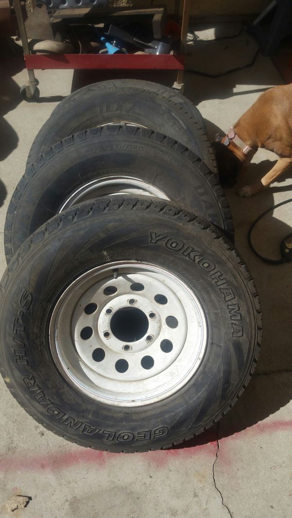 Have a set of 4 235/75/15 used tires and wheels, 6 lug trailer.