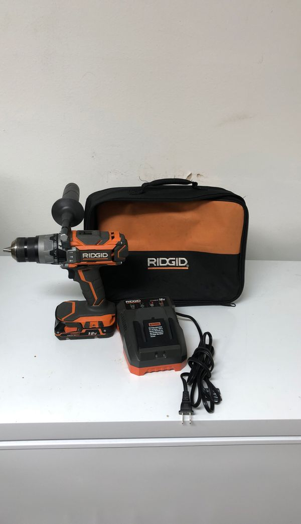 RIDGID 18-Volt Lithium-Ion Cordless Brushless 1/2 in. Compact Hammer Drill Kit with one 2.0 Ah Battery, Charger, and Bag
