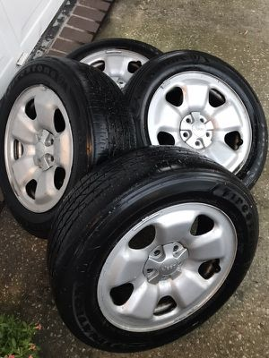 3 Jeep Cherokee wheels with used Firestone tires for Sale in Tampa, FL