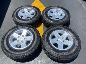 """(4) 17"""" Jeep Wrangler Wheels + 255/75R17 Goodyear Wrangler SRA - $325 for Sale in Santa Ana, CA"""