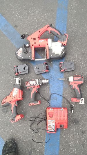 Milwaukee M18 cordless band saw hacksaw drill driver and impact driver with three batteries and charger included for Sale in Los Angeles, CA