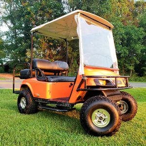 CLEAN CUSTOM LIFTED EZGO GOLF CART! BACK SEAT KIT & MORE! ENCLOSURE!! for Sale in Creedmoor, NC