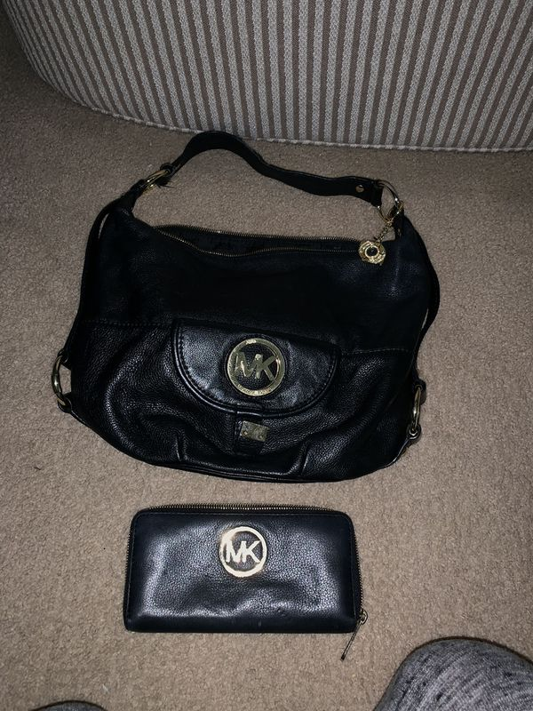 Michael Kors black leather hobo bag with matching wallet
