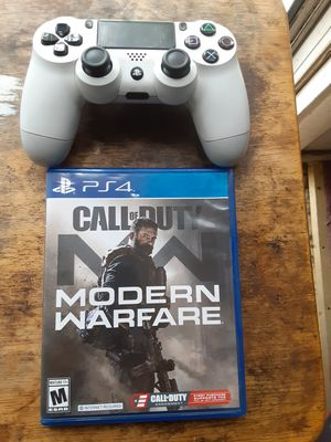 PS4 controller and COD MW PS4 game for Sale in Washington, DC