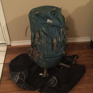 Like *NEW* Gregory Deva 60 backpack with protective duffle bag for Sale in Austin, TX