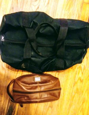 Men's large black duffle bag and men's brown leather personal items travel bag for Sale in Dallas, TX