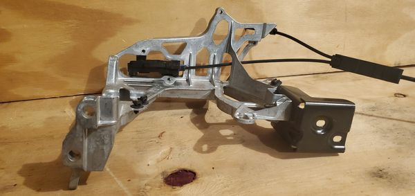 Brace bracket OEM Part # A2056221600 and smaller bracket A2056261300 with lock latch for Mercedes Benz