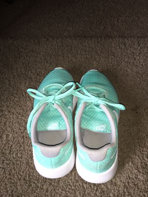Turquoise Nike shoes 4.5 in youth for Sale in Anchorage, AK