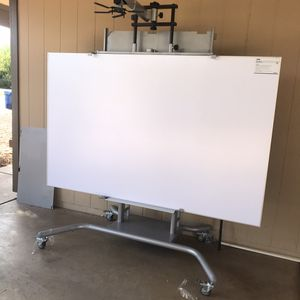 shelves with electric whiteboard, raise and lower the board, but you can add the projector on top, in good condition Se habla español for Sale in Chandler, AZ