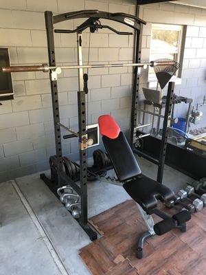 Home gym - Squat rack, adjustable bench, dumbbells and plates plus accessories. for Sale in Casselberry, FL