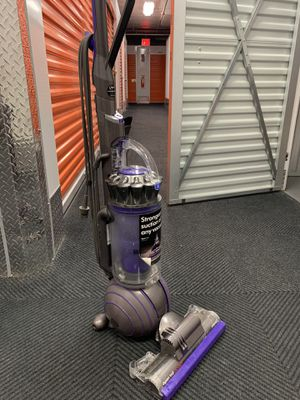 The Dyson Ball Animal 2 pet vacuum cleaner head drives deep into carpet fibers to capture dust, animal hair and ground-in dirt. for Sale in New York, NY