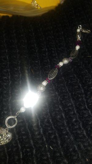 8 inch long charm bracelet . Silver lobster clasp. for Sale in Kenosha, WI