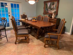 Solid wood dining room table 6 or 4 chair quantity.recently reappostered . for Sale in Miami, FL