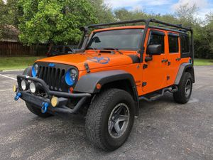 2013 Jeep Wrangler Unlimited 4WD 4dr Freedom Edition SUV 6 speed manual for Sale in Pembroke Pines, FL