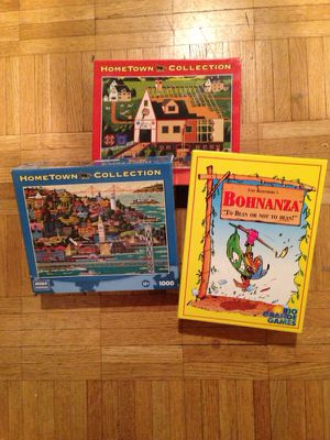 Two puzzles and Bohnanza game for Sale in Millcreek, UT